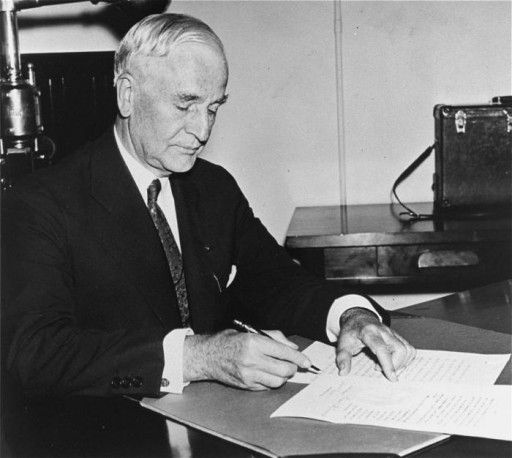 <p>Portrait of Secretary of State Cordell Hull signing President Franklin D. Roosevelt's neutrality proclamation. September 5, 1939. </p>