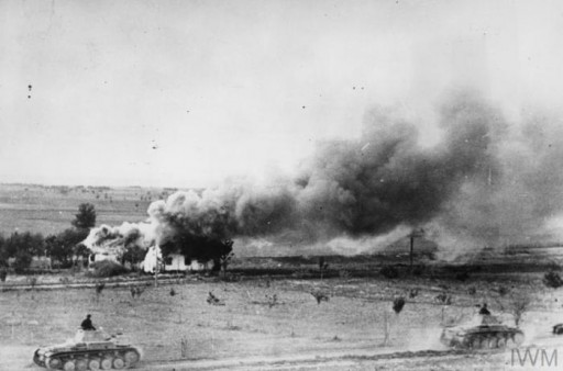 "<p>German tanks pass a burning Russian village during Operation Barbarossa, the <a href=""/narrative/2972/en"">invasion of the Soviet Union</a>, in the  summer of 1941.</p>