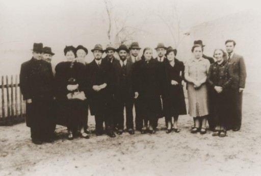 <p>November 1938 group portrait of Jews of Polish nationality who were expelled from Nuremberg, Germany, to the Polish border town of Zbaszyn. The Jewish refugees were stranded on the border and were denied admission into Poland after their explusion from Germany.<br /><br />Pictured from left to right are: Leo Fallmann; Rosa Fallmann; Mr. Auerbach; Mr. Zahn; unknown; unknown; Chaim Kupfermann; Anni Kupfermann; Simon Wassermann; unknown; Regina Holzer; and Bertha Holzer.</p>