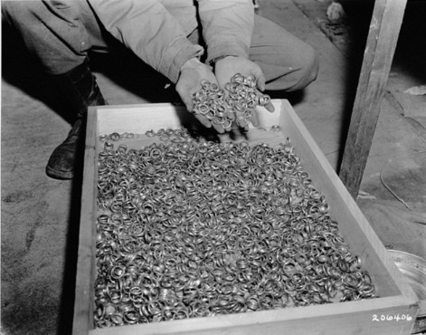 """<p>Wedding rings taken from prisoners. The rings were found near the<a href=""""/narrative/3956/en"""">Buchenwald</a>concentration camp following liberation by US Army soldiers.Germany, May 1945.</p>"""