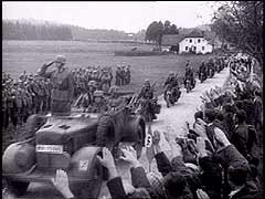 <p>This footage shows German forces entering the Sudetenland. Under the terms of the Munich Pact, Germany annexed this largely German-speaking region from Czechoslovakia. Germany, Italy, Britain, and France were party to the pact, which averted war. Czechoslovakia, however, was not permitted to attend the Munich conference. Hitler later violated the Munich Pact by destroying the Czech state in March 1939.</p>