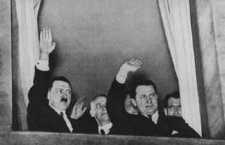 <p>Adolf Hitler, Wilhelm Frick, and Hermann Göring wave to a torchlight parade in honor of Hitler's appointment as chancellor. Behind Goering stands Rudolf Hess. Berlin, Germany, January 30, 1933.</p>