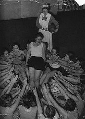 "<p>Members of the Nazi <a href=""/narrative/11357/en"">girls' organization</a>, the League of German Girls (BDM), do a group exercise. Dresden, Germany, December 1936.</p>"
