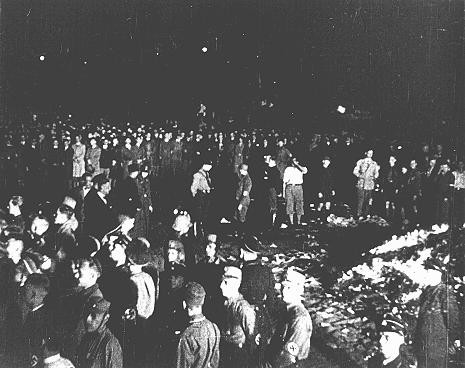"""<p>At Berlin's Opernplatz, crowds of German students and members of the SA gather for the <a href=""""/narrative/7631/en"""">burning of books</a> deemed """"un-German."""" Berlin, Germany, May 10, 1933.</p>"""