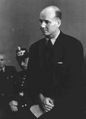 "<p>Carl Heinrich Langbehn was an attorney who was slated for a possible cabinet seat had the <a href=""/narrative/12002/en"">July 1944 attempt on Hitler's life</a> succeeded. He is pictured here on trial before the People's Court in Berlin. Langbehn was executed in the Ploetzensee prison on October 12, 1944.</p>"