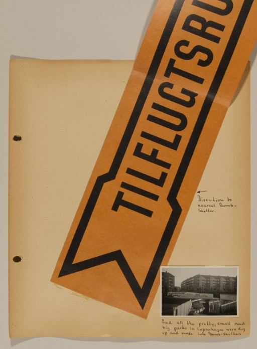 """<p>Page from volume 1 of a set of scrapbooks compiled by Bjorn Sibbern, a Danish policeman and resistance member, documenting the German occupation of <a href=""""/narrative/4236/en"""">Denmark</a>. Bjorn's wife Tove was also active in the Danish resistance. After World War II, Bjorn and Tove moved to Canada and later settled in California, where Bjorn compiled five scrapbooks dedicated to the Sibbern's daughter, Lisa. The books are fully annotated in English and contain photographs, documents and three-dimensional artifacts documenting all aspects of the German occupation of Denmark. This page contains a sign to a bomb shelter.</p>"""