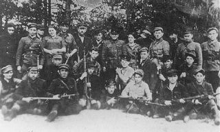 <p>Partisans in the Naliboki forest, near Novogrudok. They were from various fighting units including the Bielski group and escapees from the Mir Ghetto on guard duty at an airstrip in the Naliboki Forest. Poland, July 1944.</p>
