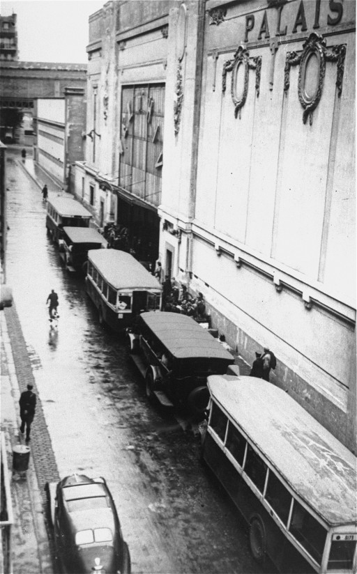 "<p>Buses waiting at the entrance to the <a href=""/narrative/11768/en"">Vélodrome d'Hiver</a>, where almost 13,000 Jews were assembled before being transported to Drancy and other French transit camps. Paris, France, July 16 and 17, 1942.</p>"