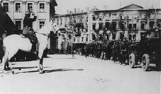 <p>German soldiers parade in Pilsudski Square. Warsaw, Poland, October 4, 1939.</p>