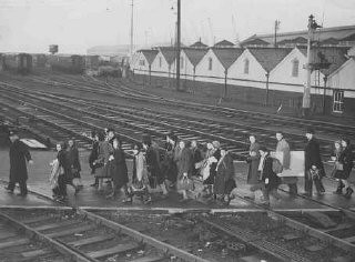 "<p>Jewish refugee children, part of a Children's Transport (<a href=""/narrative/4604/en""><em>Kindertransport</em></a>) from Germany, soon after arriving in Harwich. Great Britain, December 2, 1938.</p>"
