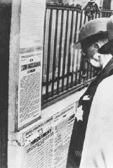"<p>A Jewish man wearing a yellow star reads newly posted antisemitic regulations in <a href=""/narrative/4669/en"">Budapest</a>. Hungary, 1944.</p>"