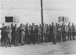 <p>Prisoners in the Janowska camp orchestra, which performed as workers were taken to and from forced labor. Poland, between 1941 and 1943.</p>