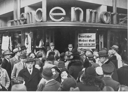 <p>Germans in front of a Jewish-owned department store in Berlin during the anti-Jewish boycott. Berlin, Germany, April 1, 1933.</p>