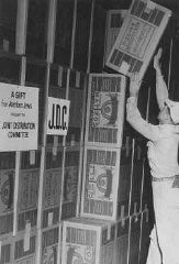 """<p>Boxes of matzah in a <a href=""""/narrative/5002/en"""">Joint Distribution Committee</a> warehouse before distribution to Jewish survivors in <a href=""""/narrative/6365/en"""">displaced persons camps</a>. Place uncertain, postwar.</p>"""