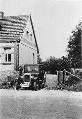 """<p>The Kusserow family home in Bad Lippspringe. The family, <a href=""""/narrative/5070/en"""">Jehovah's Witnesses</a>, kept religious materials in the trunk of the car and distributed them from it as well. The Kusserow family was active in their region distributing religious literature and teaching Bible study classes in their home. Their house was conveniently situated for fellow Witnesses along the tram route connecting the cities of Paderborn and Detmold. For the first three years after the <a href=""""/narrative/65/en"""">Nazis came to power</a>, the Kusserows endured moderate persecution by local Gestapo agents, who often came to search their home for religious materials. In 1936, Nazi police pressure increased dramatically, eventually resulting in the arrest of the family and its members' internment in various concentration camps. Most of the family remained incarcerated until the end of the war. Bad Lippspringe, Germany, 1933-1937.</p>"""