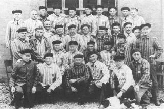"""<p>A group of <a href=""""/narrative/5070/en"""">Jehovah's Witnesses</a> in their camp uniforms after <a href=""""/narrative/2317/en"""">liberation</a>. These men were imprisoned in the Niederhagen bei Wewelsburg concentration camp. Niederhagen bei Wewelsbug, Germany, 1945.</p>"""