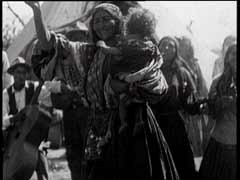 "<p><a href=""/narrative/5123/en"">Roma (Gypsies)</a> celebrate with music, dancing, and singing in the mountains near Zagreb, Yugoslavia. During World War II, <a href=""/narrative/4500/en"">Roma</a> in Yugoslavia were exterminated by Croatian nationalists and by the Germans.</p>"