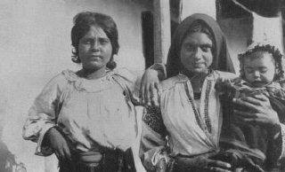 "<p><a href=""/narrative/5123/en"">Romani (Gypsy) women and child</a>. Romania, 1930s.</p>"