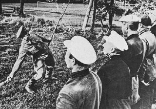 <p>A Soviet army instructor trains partisans in the use of grenades. Soviet Union, wartime.</p>