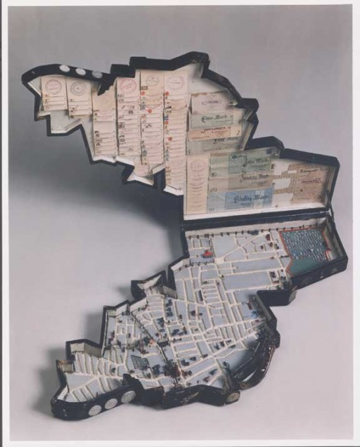 <p>Leon Jakubowicz, a shoemaker by training and a native of Lodz, began constructing this model of the Lodz ghetto soon after his arrival there from a prisoner-of-war camp in April 1940. The case holds a scale (1:5000) model of the ghetto, including streets, painted houses, bridges, churches, synagogue ruins, factories, cemeteries, and barbed wire around the ghetto edges. The model pieces are made from scrap wood. The case cover interior is lined with a collection of official seals, a ration card, and paper money, and the case exterior is covered with metal coins.</p>