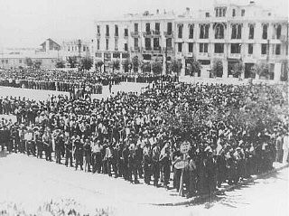 "<p>Some 7,000 Jewish men ordered to register for <a href=""/narrative/3384/en"">forced labor</a> assemble in Liberty Square in German-occupied <a href=""/narrative/5364/en"">Salonika</a>. Salonika, Greece, July 1942.</p>"