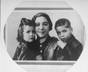 "<p>1942 portrait of Ita Guttman with her twin children <a href=""/narrative/20704/en"">Rene and Renate</a>. When the twins were very young, the family moved to Prague. In the fall of 1941 the Germans arrested Ita's husband, Herbert. Subsequently, the twins and their mother were deported to <a href=""/narrative/5386/en"">Theresienstadt</a>, and from there, to <a href=""/narrative/3673/en"">Auschwitz</a>. </p>"