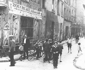 "<p>Street scene in the Jewish quarter of <a href=""/narrative/6033/en"">Paris</a> before World War II and the Holocaust. Paris, France, 1933–39.</p>"