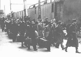 "<p>Foreign Jews arrested in Paris at the Austerlitz train station before deportation to the French-administered internment camps Pithiviers and Beaune-la-Rolande in the Loire region. <a href=""/narrative/6033/en"">Paris</a>, France, ca. May 1941.</p>"
