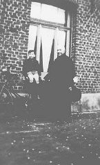 "<p>A Jewish child, Jacky Borzykowski, with the priest who placed him in <a href=""/narrative/7711/en"">hiding</a> on a farm. Belgium, 1943.</p>"