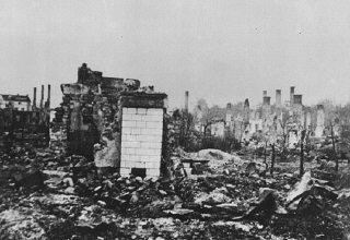 """<p>A Polish town lies in ruins following the <a href=""""/narrative/2103/en"""">German invasion of Poland</a>, which began on September 1, 1939.</p>"""
