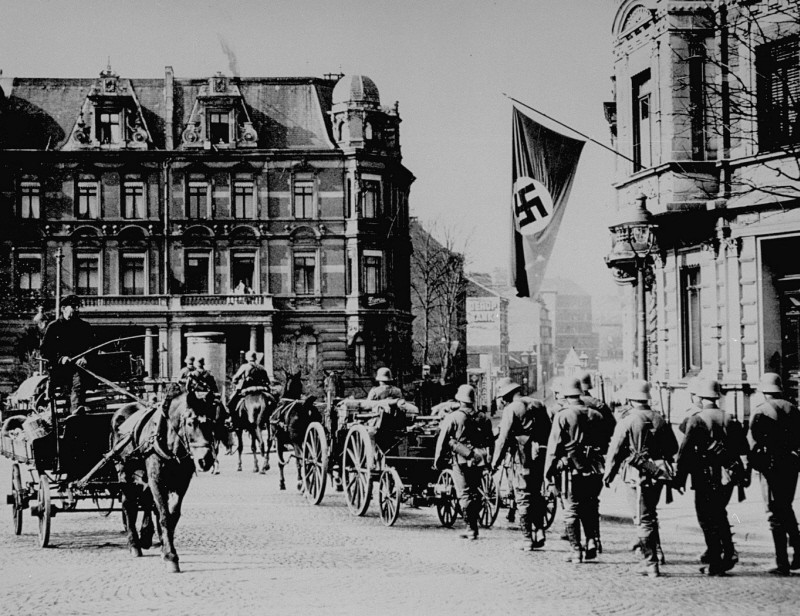 <p>German forces enter Aachen, on the border with Belgium, following the remilitarization of the Rhineland. Aachen, Germany, March 18, 1936.</p>