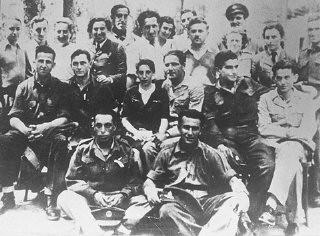 "<p>Group of <a href=""/narrative/5666/en"">Jewish parachutist</a>s under British command including Haviva Reik (center), who was sent into Slovakia. Palestine, wartime.</p>"