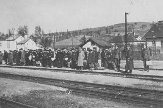 <p>Jews at the railroad station before deportation. Puchov, Czechoslovakia, March 1942. (Source record ID: E39 Nr.2447/8)</p>
