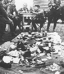 "<p>Ustasa (Croatian fascist) guards alongside belongings of prisoners at the Jasenovac concentration camp. <a href=""/narrative/6153/en"">Yugoslavia</a>, between 1941 and 1945.</p>"