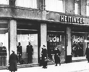 """<p>Windows of a Jewish-owned store painted with the word <em>Jude</em> (Jew). <a href=""""/narrative/5908/en"""">Berlin</a>, Germany, June 19, 1938.</p>"""