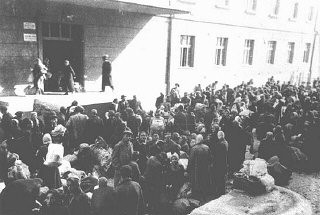 "<p>Jews outside the Monopol tobacco factory, used as a transit camp by Bulgarian authorities during deportations from Macedonia to the <a href=""/narrative/3819/en"">Treblinka killing center</a> in German-occupied Poland. Skopje, <a href=""/narrative/6153/en"">Yugoslavia</a>, March 1943.</p>