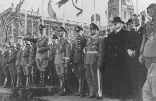 "<p>Adolf Hitler and his entourage view a military parade following the annexation of <a href=""/narrative/5815/en"">Austria</a> (the <em>Anschluss</em>). Vienna, Austria, March 1938.</p>"