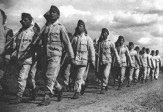"""<p>Conscripts in the Hungarian Labor Service march to a work site. Mateszalka, <a href=""""/narrative/6206/en"""">Hungary</a>, September 1939.</p>"""