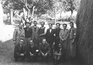 """<p>Twelve Hungarian Jewish physicians in the Iklad forced-labor camp. Iklad, <a href=""""/narrative/6206/en"""">Hungary</a>, September 24, 1940.</p>"""