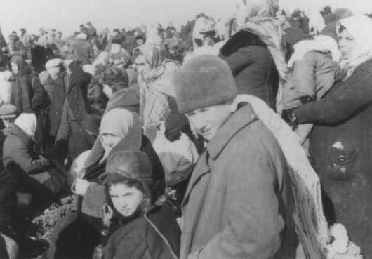 <p>Roundup of the Jews of Lubny, shortly before they were massacred by Einsatzgruppe detachments. This photo, originally in color, was part of a series taken by a German military photographer. Copies from this collection were later used as evidence in war crimes trials. Lubny, Soviet Union, October 16, 1941.</p>
