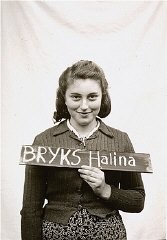 <p>Halina Bryks was photographed in the Kloster Indersdorf children's center in an attempt to help locate surviving relatives. Photographs such as this one showing children holding name cards were published in newspapers to facilitate the reunification of families. Germany, after May 1945.</p>