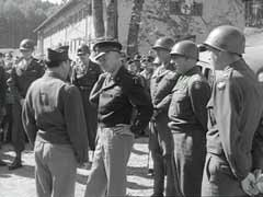 <p>In this footage, General Dwight Eisenhower, General George Patton, and Major General Lewis Craig inspect conditions at the Feldafing displaced persons camp near Wolfratshausen, Germany. Feldafing was one of the first displaced persons camps to house primarily Jewish refugees. In August 1945, Eisenhower ordered that Feldafing be used as a model for the establishment of other camps for Jewish displaced persons in the US occupation zones of Germany and Austria.</p>