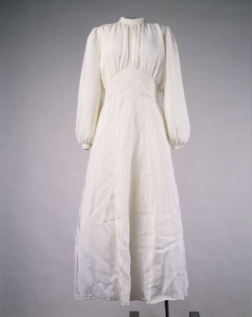 <p>This wedding dress was made from a parachute and worn by Lilly Lax for her wedding to Ludwig Friedman in a displaced persons camp. Ludwig had promised to find fabric for a white gown, and purchased an old parachute for this purpose. Lilly hired a seamstress to make the dress in exchange for her cigarette ration. Other brides in the Celle and Belsen displaced persons camps subsequently wore the dress. Lilly and Ludwig immigrated to the United States in 1948.</p>