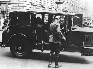 <p>After Adolf Hitler became chancellor of Germany, he persuaded his cabinet to declare a state of emergency and end many individual freedoms. Here, police search a vehicle for arms. Berlin, Germany, February 27, 1933.</p>