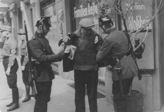 <p>Police search in Berlin. Members of the SA stand nearby. Berlin, Germany, 1933.</p>