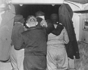 "<p>Jewish <a href=""/narrative/2419/en"">refugee</a> children look out of the train window as they leave Berlin. They were on a <a href=""/narrative/4604/en""><em>Kindertransport</em></a> from Germany. Schlesischen train station, Berlin, Germany, November 29-30, 1938.</p>"