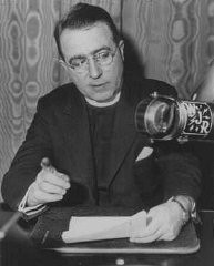 <p>Father Charles Coughlin, leader of the antisemitic Christian Front, delivers a radio broadcast. Detroit, United States, March 11, 1935.</p>