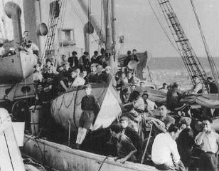 "<p>Jewish refugees on board the <a href=""/narrative/7475/en"">Aliyah Bet</a> (""illegal"" immigration) ship <em>Atrato</em>. The ship was caught by the British off the coast of Jaffa, Palestine, and escorted to Haifa port. July 17, 1939.</p>"