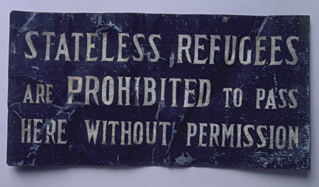 "<p>One of many signs displayed along the Shanghai ghetto's boundaries: ""Stateless Refugees are Prohibited to Pass Here without Permission"". This plaque was removed by a refugee at the end of the war. [From the USHMM special exhibition Flight and Rescue.]</p>"