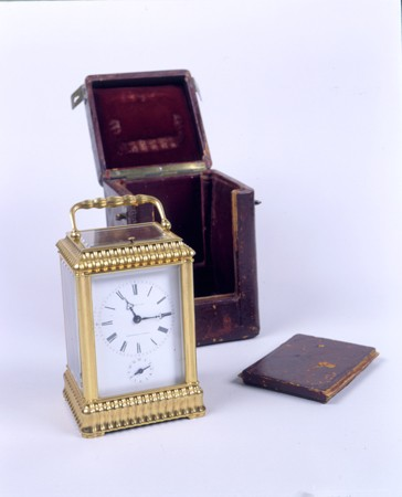 <p>A seven-day gold traveling clock in a leather case, manufactured in France and originally made for a Russian nobleman. The panel in the leather case slides open to reveal the clock face. The clock was a Szepsenwol family heirloom. It was acquired by Chaya Szepsenwol's grandfather, who like her father, was a jeweler. The clock was among the family valuables that Rikla Szepsenwol was able to take out of Poland. [From the USHMM special exhibition Flight and Rescue.]</p>
